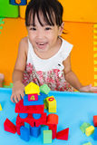 Asian Little Chinese Girl Playing Wooden Blocks Royalty Free Stock Images