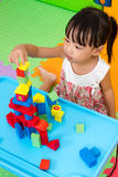 Asian Little Chinese Girl Playing Wooden Blocks Stock Photo