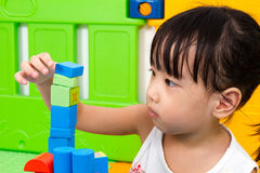 Asian Little Chinese Girl Playing Wooden Blocks Royalty Free Stock Image