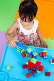 Asian Little Chinese Girl Playing Wooden Blocks Stock Photography