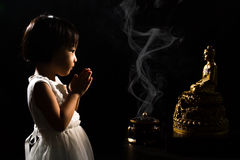 Asian Little Chinese Girl Praying in front of Buddha Royalty Free Stock Image