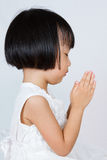 Asian Little Chinese Girl Praying. In isolated White Background Stock Image