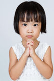 Asian Little Chinese Girl Praying. In isolated White Background Royalty Free Stock Photo