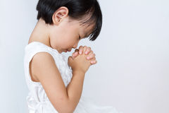 Asian Little Chinese Girl Praying Royalty Free Stock Photography