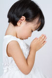 Asian Little Chinese Girl Praying. In isolated White Background Royalty Free Stock Images