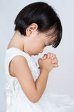 Asian Little Chinese Girl Praying. In isolated White Background Royalty Free Stock Photography