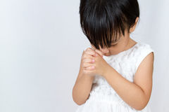 Asian Little Chinese Girl Praying. In  White Background Royalty Free Stock Photo
