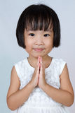 Asian Little Chinese Girl Praying. In  White Background Stock Photography