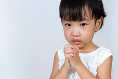 Asian Little Chinese Girl Praying. In  White Background Royalty Free Stock Image