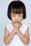 Asian Little Chinese Girl Praying. In  White Background Stock Photos