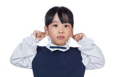 Asian Little Chinese Girl pulling her ears. In isolated White Background Stock Photo
