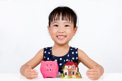 Asian Little Chinese Girl Saving Money for Property Concept Royalty Free Stock Images