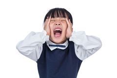 Asian Little Chinese Girl screaming with hands on her face Stock Photography
