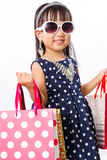 Asian Little Chinese Girl with Shopping Bag. Isolated on White Background Royalty Free Stock Photography
