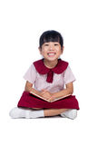 Asian Little Chinese girl sitting on floor and reading book Stock Images