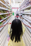 Asian Little Chinese Girl sitting in shopping cart Stock Photography