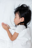 Asian little Chinese girl sleeping on the bed. At home Royalty Free Stock Photo