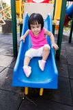 Asian Little Chinese Girl sliding Stock Images
