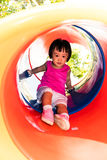 Asian Little Chinese Girl sliding Royalty Free Stock Photos