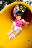 Asian Little Chinese Girl sliding Stock Photo