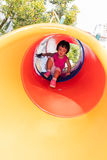 Asian Little Chinese Girl sliding Stock Photography