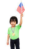 Asian Little Chinese Girl Smiles with a Flag and Gold Medal Stock Photos
