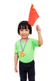 Asian Little Chinese Girl Smiles with a Flag and Gold Medal Royalty Free Stock Photo