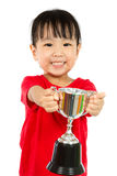 Asian Little Chinese Girl Smiles with a Trophy in Her Hands. Isolated on White Background stock photo
