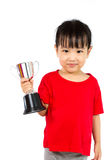 Asian Little Chinese Girl Smiles with a Trophy in Her Hands. Isolated on White Background stock photos