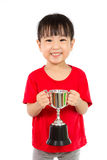 Asian Little Chinese Girl Smiles with a Trophy in Her Hands. Isolated on White Background stock images