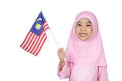 Asian Little Chinese Girl in traditional Malay costume holding M. Alaysian flag in isolated white background stock images