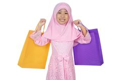 Asian Little Chinese Girl in traditional Malay costume holding s. Hopping bags in isolated white background stock photos
