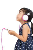 Asian Little Chinese Girl Using Mobile Phone with Headset Royalty Free Stock Photo