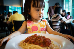 Asian Little Chinese Girl Waiting to Eat Spaghetti Stock Photos