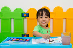 Asian Little Chinese Girl Washing Painting Brush Royalty Free Stock Photo
