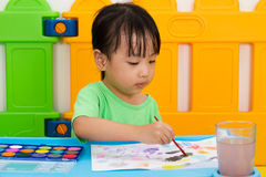 Asian Little Chinese Girl Washing Painting Brush Royalty Free Stock Images
