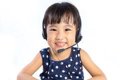 Asian Little Chinese Girl Wearing Headset Royalty Free Stock Images