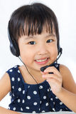 Asian Little Chinese Girl Wearing Headset Stock Photo