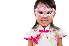 Asian Little Chinese Girl Wearing Mask. Isolated on White Bakground Stock Photo