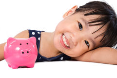Asian Little Chinese Girl With Piggy Bank Stock Photos