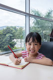 Asian little Chinese girl writing homework Stock Photography