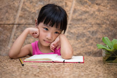 Asian little Chinese girl writing homework Royalty Free Stock Images