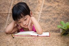 Asian little Chinese girl writing homework Royalty Free Stock Image