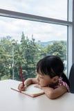 Asian little Chinese girl writing homework Stock Images