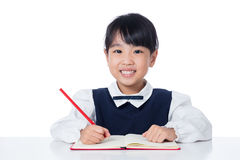 Asian Little Chinese girl writing homework Royalty Free Stock Photography