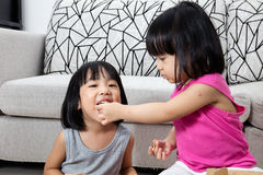 Asian Little Chinese Girls Eating Pizza. At Home royalty free stock images