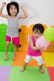 Asian Little Chinese Girls Playing with Balloons Stock Photo