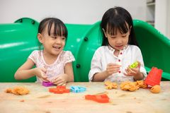Asian Little Chinese Girls Playing Colorful Clay. In Indoor Playground stock photos