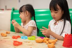Asian Little Chinese Girls Playing Colorful Clay. In Indoor Playground royalty free stock photos