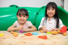 Asian Little Chinese Girls Playing Colorful Clay. In Indoor Playground royalty free stock photo